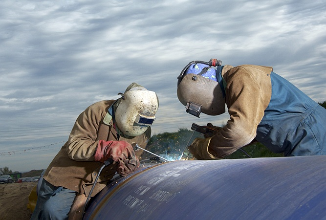 Commercial Photographer, Water pipeline installation, welding, UK